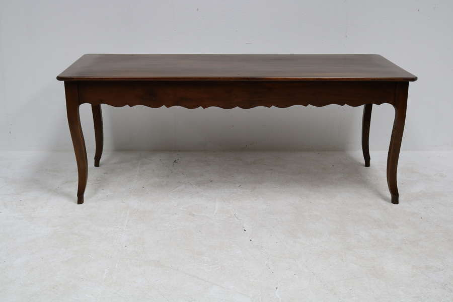 A French cherry wood cabriole leg dining table with breadslide ends