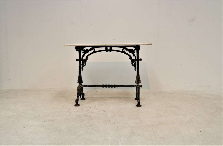 A 19th century cast iron and marble bistro table