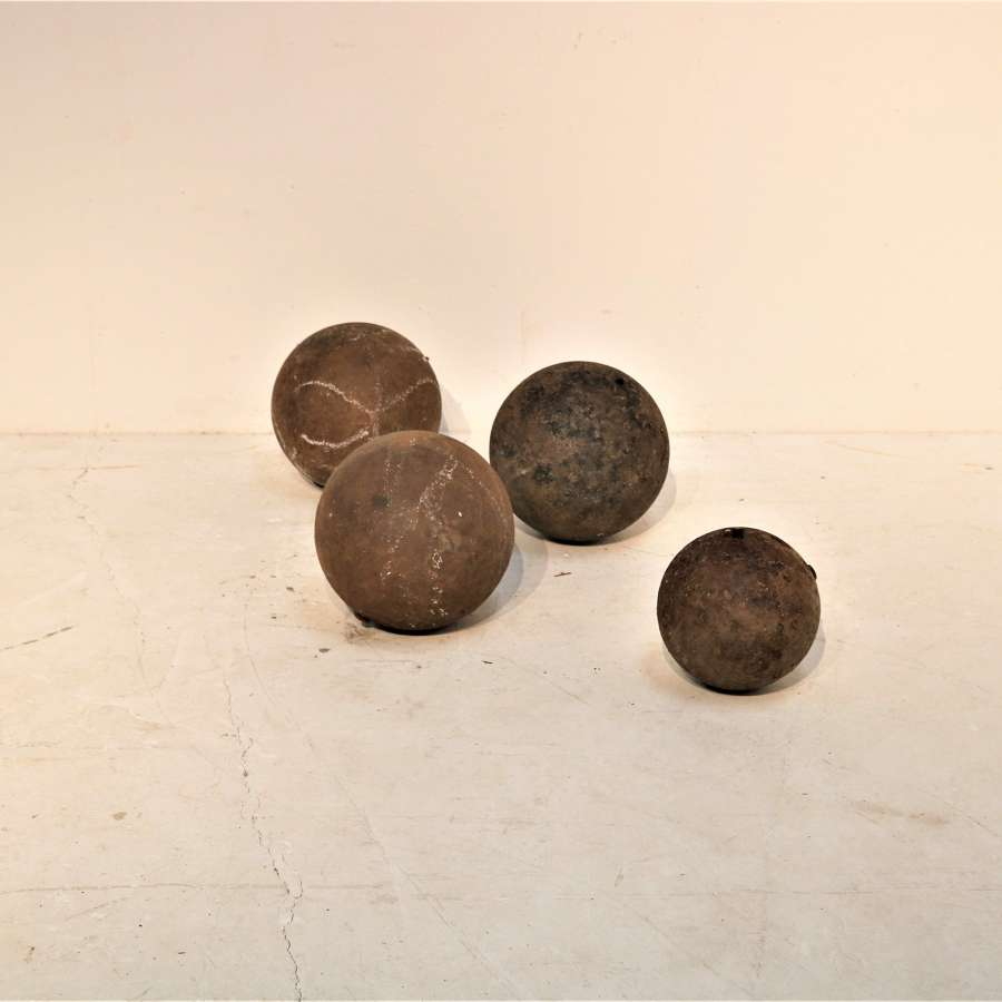 A set of four cast iron English boat weights circa 1900