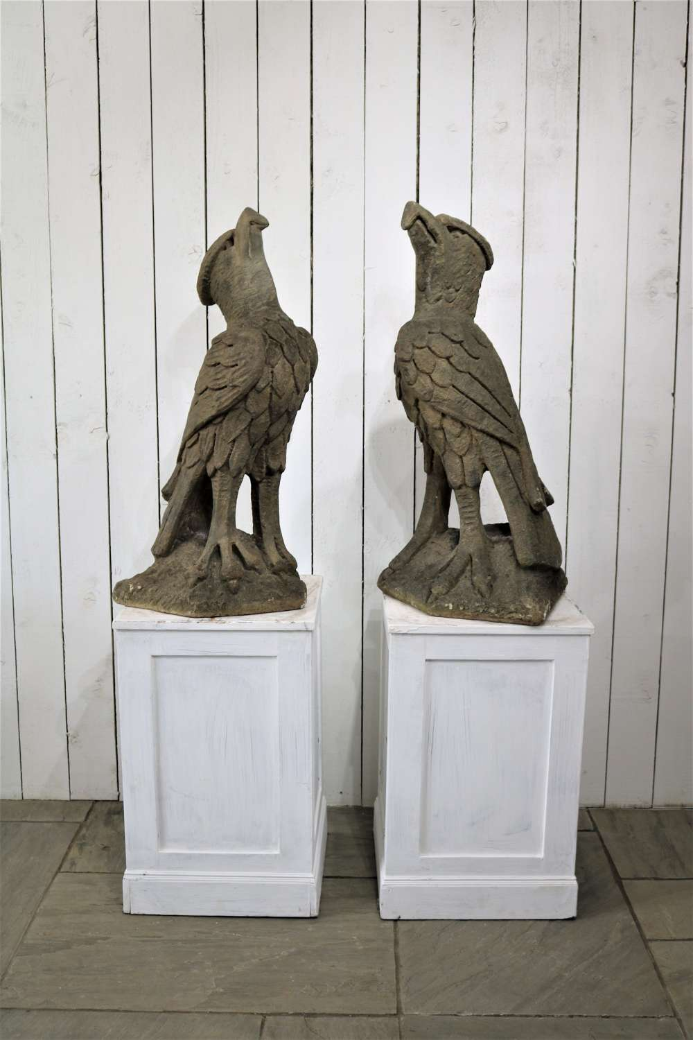 A pair of late 19th century carved stone eagles circa 1890